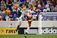 Dane Richards (19) of the New York Red Bulls and Mike Chabala (4) of the Portland Timbers. The New York Red Bulls defeated the Portland Timbers 2-0 during a Major League Soccer (MLS) match at Red Bull Arena in Harrison, NJ, on September 24, 2011.
