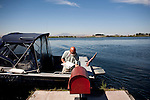 Rick Stelzriede delivers mail by boat in the Delta, September 15, 2010.