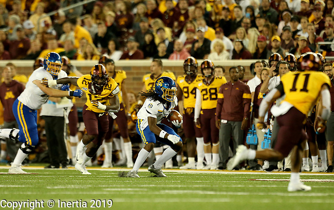 MINNEAPOLIS, MN - AUGUST 29: C.J. Wilson #8 from South Dakota State University scampers away from the defense of the University of Minnesota during their game Thursday night at TCF Bank Stadium in Minneapolis, MN. (Photo by Dave Eggen/Inertia)