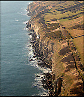 BNPS.co.uk (01202 558833)<br /> Pic: RachelAdams/BNPS<br /> <br /> The cliffs west of Anvil point.<br /> <br /> Pippa the dog had a miracle escape after she plunged off a 100ft cliff and survived by landing in the sea below.<br /> <br /> The black labrador was being taken for a walk when she suddenly became excited at seeing the sea in the distance.<br /> <br /> She ran off from owners Daniel and Katy Pordage, dashed 500 yards across two fields towards the edge of the cliff without realising the danger.<br /> <br /> Incredibly, Pippa landed in the an area of water between two rocks 100ft below and suffered just an injured front paw in the death-defying fall.<br /> <br /> Two climbers who were abseiling down to scale the cliff at Anvil Point, near Swanage, Dorset, plucked the dog out of the water and held on to her until a lifeboat crew arrived.<br /> <br /> Pippa was taken aboard and ferried to the lifeboat station where she was reunited with her relieved owners.<br /> <br /> Katy, a 27-year-old vetinery nuse, looked at the three-year-old pooch and thought she had broken her front right leg but a further examination revealed just a damaged tendon.<br /> <br /> Katy and Daniel, a 32-year-old web designer from Hythe, near Southampton, were enjoying a break on the Isle of Purbeck with their dogs, Pippa and Marley.