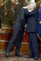 Roma, 28 Aprile 2013.Palazzo Chigi.Primo giorno del Governo Letta.Nella foto Mario Monti e Enrico Letta si abbracciano