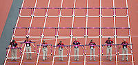 03 AUG 2012 - LONDON, GBR - Gamesmakers lay out hurdles for the women's heptathlon 100m hurdles heats during the London 2012 Olympic Games athletics at the Olympic Stadium in the Olympic Park in Stratford, London, Great Britain (PHOTO (C) 2012 NIGEL FARROW)
