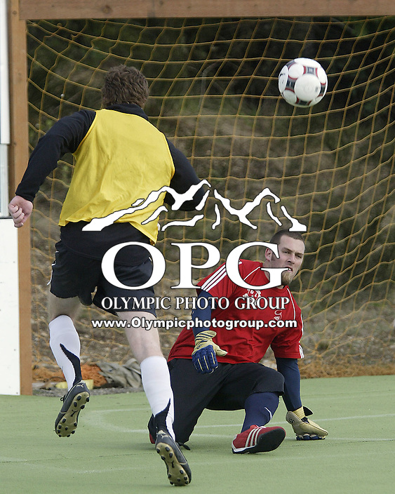 Kitsap Pumas keeper Dustyn Brim clears the net during practice at Misty Acres Camp 4-2-09.