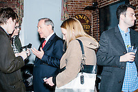 Former Virginia governor and Republican presidential candidate Jim Gilmore speaks with Daily Caller reporter Alex Pfeiffer (left) at the Gilmore primary watch party at Fratello's in Manchester, New Hampshire, on the day of primary voting, Feb. 9, 2016. Gilmore finished in last place among major Republican candidates still in the race with a total of 150 votes.