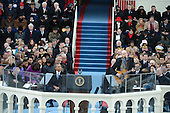 President Barack Obama watches musician James Taylor sing before being sworn-in for a second term as the President of the United States by Supreme Court Chief Justice John Roberts during his public inauguration ceremony at the U.S. Capitol Building in Washington, D.C. on January 21, 2013.   .Credit: Pat Benic / Pool via CNP