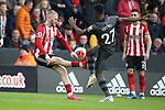 Oli McBurnie of Sheffield Utd and Alexander Tettey of Norwich City during the Premier League match at Bramall Lane, Sheffield. Picture date: 7th March 2020. Picture credit should read: Alistair Langham/Sportimage