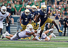 Sept. 26, 2015; Wide receiver Chris Brown pushes past University of Massachusetts defense the first half at Notre Dame Stadium. (Photo by Barbara Johnston/University of Notre Dame)