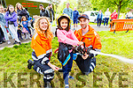 Paulina Barszczewska gets a Fire Hose demonstration from the Civil Defence at Feile na mBlath in the Tralee town park on Saturday.<br /> L to r: Shane Callaghan, Paulina Barszczewska and Karolina Taranta Sova.