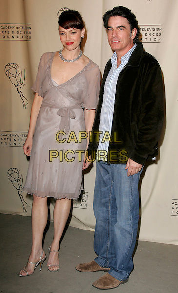 """MELINDA CLARKE & PETER GALLAGHER.attends """"The O.C. Revealed"""" presented by The Academy of Television Arts & Sciences held at Warner Brother Studios at The Steven Ross Theatre in Burbank, California, USA, March 21st 2005.full length grey beige chiffon dress belt belted.www.capitalpictures.com.sales@capitalpictures.com.©Debbie VanStory/Capital Pictures"""