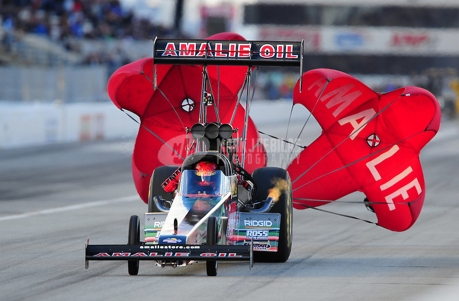 Feb. 26, 2011; Pomona, CA, USA; NHRA top fuel dragster driver Terry McMillen during qualifying at the Winternationals at Auto Club Raceway at Pomona. Mandatory Credit: Mark J. Rebilas-.