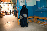 Egypt / Cairo / 22.12.2012 / A woman waits in a polling station in Doqqi's area: Egyptians cast their ballots during the second day of the constitutional referendum, on December 22nd. © Giulia Marchi