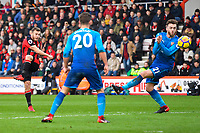 Ryan Fraser of AFC Bournemouth left has a shot on goal as Calum Chambers of Arsenal (r) takes avoiding action during AFC Bournemouth vs Arsenal, Premier League Football at the Vitality Stadium on 14th January 2018
