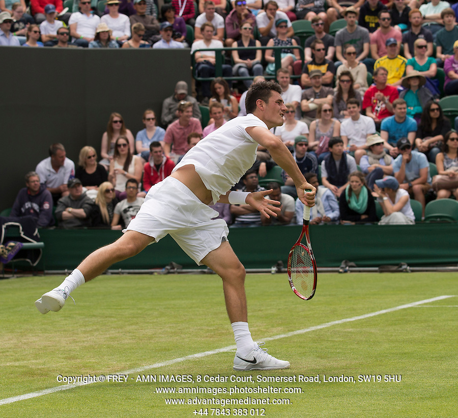 Bernard Tomic<br /> Tennis - The Championships Wimbledon  - Grand Slam -  All England Lawn Tennis Club  2013 -  Wimbledon - London - United Kingdom - Tuesday 25th June  2013. <br /> &copy; AMN Images, 8 Cedar Court, Somerset Road, London, SW19 5HU<br /> Tel - +44 7843383012<br /> mfrey@advantagemedianet.com<br /> www.amnimages.photoshelter.com<br /> www.advantagemedianet.com<br /> www.tennishead.net