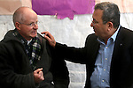 Defense Minister and Labor Party leader Ehud Barak, right, speaks with Noam Schalit, the father of Israeli soldier Sgt. Gilad Schalit, who was captured by Palestinian militants in 2006, in a solidarity tent outside the Prime Ministers' residence in Jerusalem, Monday, March 9, 2009. Schalit's parents have set up camp outside Prime Minister Ehud Olmert's residence, vowing to stay there until the end of his term to try to pressure his government to bring their son home. Monday marked Gilad Schalit's 988th day in captivity. Photo By : Emil Salman / JINI