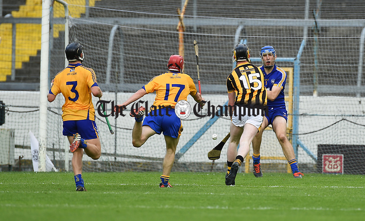 John Walsh of Kilkenny scores their fifth goal against Daniel Vaughan, Eoin Quirke and Eoin Enright of Clare during their Intermediate All-Ireland final at Thurles. Photograph by John Kelly.