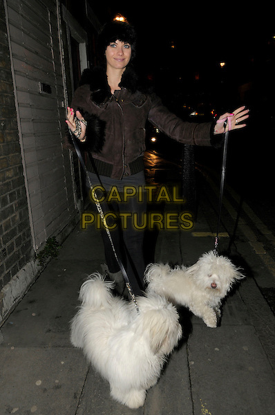 Jessica-Jane Clement spotted in central London taking her two dogs (Knickers and Pants) for a walk, England..5th January 2012.full length dog animal pet leash lead black hat brown jacket.CAP/IA.©Ian Allis/Capital Pictures.