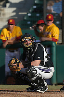Jake Straub #11 of the Northwestern Wildcats plays catcher during a game against the USC Trojans at Dedeaux Field on  February 16, 2014 in Los Angeles, California. USC defeated Northwestern, 13-6. (Larry Goren/Four Seam Images)