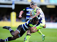 Tom Brady of Sale Sharks is tackled by Semesa Rokoduguni of Bath Rugby. Aviva Premiership match, between Bath Rugby and Sale Sharks on April 23, 2016 at the Recreation Ground in Bath, England. Photo by: Patrick Khachfe / Onside Images