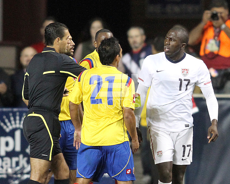 Jozy Altidore #17 of the USA MNT and John Javier Restrepo #21 of Colombia with referee Roberto Garcia during an international friendly match at PPL Park, on October 12 2010 in Chester, PA. The game ended in a 0-0 tie.