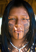 Pará State, Brazil. Aldeia Moikarako. Ngre'ok Kayapo with beautiful Kayapo face paint.