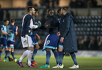 Goalkeeper Scott Brown of Wycombe Wanderers shakes hands with teammates after the Sky Bet League 2 match between Wycombe Wanderers and Newport County at Adams Park, High Wycombe, England on 2 January 2017. Photo by Andy Rowland.
