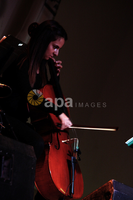 """A Palestinian member of """"Maqamat-al-Quds"""" musical band performs during the Opening of """"Music nights in Jerusalem of Arab"""" festival, in Jerusalem on November 07, 2013. The festival organised by Edward Said music conservatory for the fifth year in a row. Photo by Saeed Qaq"""