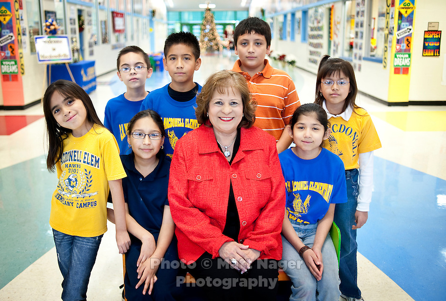 Principal Cynthia Conchas (cq) and fourth grade students at C. M. Macdonell Elementary School Friday, Dec. 11, 2009, in Laredo, Texas, who wrote letters to the B. Dalton book store company asking to not have their bookstore, the only bookstore in town, close. With over 95 percent of the population as Hispanic Spanish speakers, Laredo ranked the lowest in literacy rates in the 2000 US census. Today there are a number of bi-lingual and dual language classes set up to help students and adults learn english...PHOTOS/ MATT NAGER