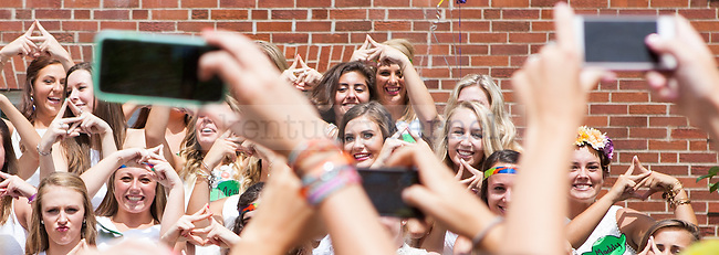 New members of Delta Zeta pose for photos during sorority bid day in Lexington, Ky. on Friday, August 21, 2015. Photo by Adam Pennavaria | Staff
