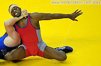 T.C. Dantzler (red) battles Cheney Haight in their first of two fights in the greco roman 74kg class at the 2008 US Olympic Team Trials at the Thomas and Mack Center. Dantzler won the series and qualified for the Olympics.