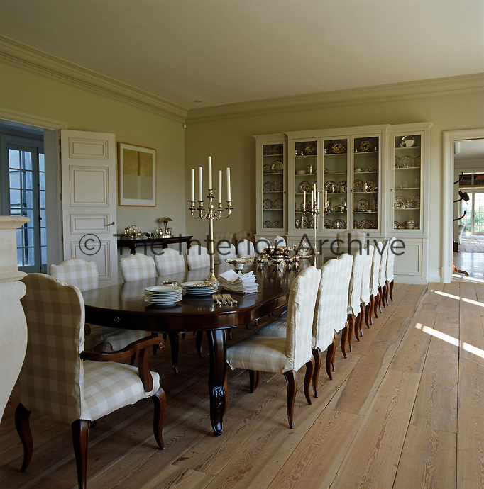 An impressive dining table is matched by a large dresser in this formal dining room