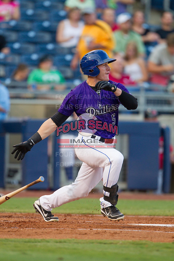 Tulsa Drillers right fielder Tyler Massey (5) drops his bat after batting during the Texas League game against the Frisco RoughRiders at ONEOK field on August 15, 2014 in Tulsa, Oklahoma  The RoughRiders defeated the Drillers 8-2.  (William Purnell/Four Seam Images)