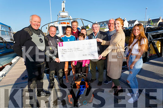 The Kerry Sub Aqua Club presented a cheque for €2,200 to the Kerry Hospice Foundation at Portmagee Pier on Saturday, this money was raise from their annual Dawn Dive held during the summer, pictured here l-r; Nigel Kelleher, Brendan Cullinane, Rebecca Coyle, John Coyle, Mairead Lynch, Anita Doody, Christy O'Connell, Gearoid Moran, Trish O'Sullivan & Ríona Moran.