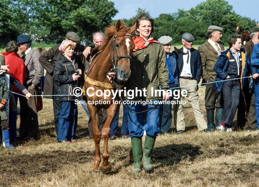 Suzanne Austin, Londonderry, N Ireland, leading a horse at Ballintra Races, Ballinstra, Co Donegal, Rep of Ireland, August 1979. In December 1980 she married Thomas Clifford, 14th Baron Clifford of Chudleigh. They had two sons and a daughter and divorced in 1992. 19790062SA..Copyright Image from Victor Patterson, 54 Dorchester Park, Belfast, UK, BT9 6RJ..Tel: +44 28 9066 1296.Mob: +44 7802 353836.Voicemail +44 20 8816 7153.Skype: victorpattersonbelfast.Email: victorpatterson@me.com.Email: victorpatterson@ireland.com (back-up)..IMPORTANT: If you wish to use this image or any other of my images please go to www.victorpatterson.com and click on the Terms & Conditions. Then contact me by email or phone with the reference number(s) of the image(s) concerned.