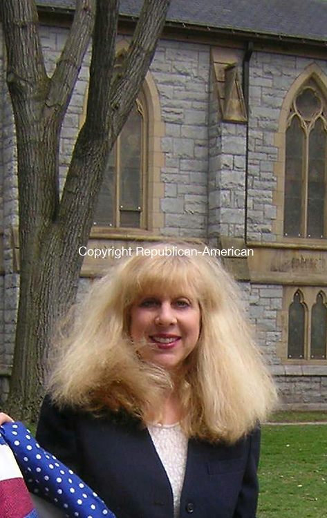 WATERBURY -- Mar. 20, 2014 -- 21_NEW_032214MDP01 -- Barbara Dublin, executive director of Greater Waterbury Interfaith Ministries, stands outside St. John's Episcopal Church. Republican-American archive.