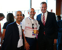 New York, New York - Friday July 10, 2015: Sunil Gulati President of the United States Soccer Federation, MLS Commissioner Don Garber and New York City Mayor Bill de Blasio attend a reception before the start of a ticker tape parade in their honor of the USWNT.