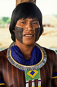 A-Ukre village, Brazil. Bengoti, Megranoti- Kayapo warrior wearing the Brazilian flag in bead work; Xingu Indigenous Area, Para state.