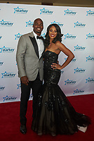 "ST. PAUL, MN JULY 16: Former Minnesota Viking Adrian Peterson poses with his wife Ashley on the red carpet at the Starkey Hearing Foundation ""So The World May Hear Awards Gala"" on July 16, 2017 in St. Paul, Minnesota. Credit: Tony Nelson/Mediapunch"
