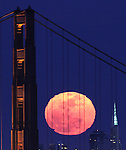 The full moon rose between the south tower of the Golden Bridge and San Francisco Transamerican Pyramid Friday night April 6, 2012. The moon officially turned full for the first time during the spring season at 3:19 p.m. ET Friday, and that astronomical fact determines the timing for the Easter season..