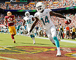 Miami Dolphins wide receiver Jarvis Landry (14) sails into the end zone on a fourth quarter 69 yard punt return to defeat the Washington Redskins at FedEx Field in Landover, Maryland on Sunday, September 13, 2015.