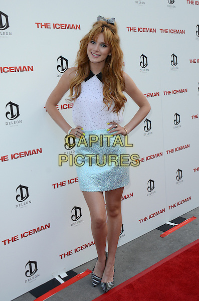 Bella Thorne.The premiere of 'The Iceman' at ArcLight Hollywood, Hollywood, California, USA..April 22nd 2013.full length blue skirt white top hands on hips.CAP/ADM/TW.©Tonya Wise/AdMedia/Capital Pictures.
