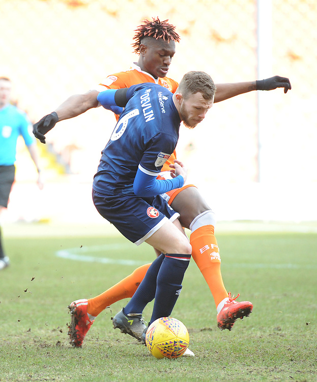 Blackpool's Chris Long vies for possession with Walsall's Nicky Devlin<br /> <br /> Photographer Kevin Barnes/CameraSport<br /> <br /> The EFL Sky Bet League One - Blackpool v Walsall - Saturday 9th February 2019 - Bloomfield Road - Blackpool<br /> <br /> World Copyright © 2019 CameraSport. All rights reserved. 43 Linden Ave. Countesthorpe. Leicester. England. LE8 5PG - Tel: +44 (0) 116 277 4147 - admin@camerasport.com - www.camerasport.com