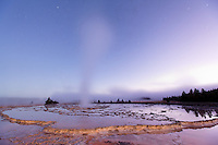 Steam rising from Great Fountain Geyser at early dawn, Firehole Lake Drive, Yellowstone National Park, Wyoming, USA