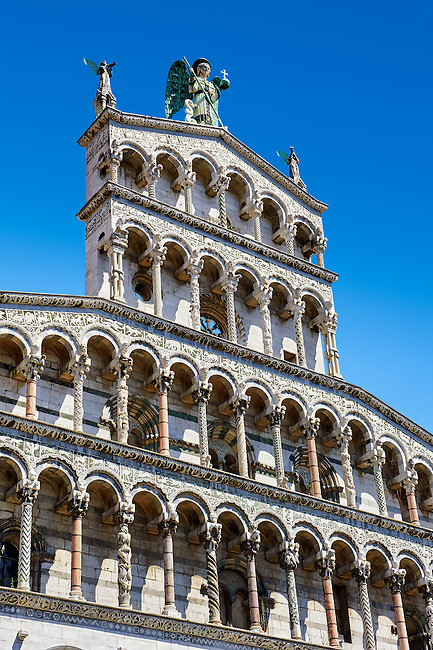 Angled Detail of the 13th century Romanesque facade of the San Michele in Foro,  a Roman Catholic basilica church in Lucca, Tunscany, Italy