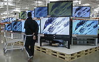 A customer peruses the HDTV section at a Costco Wholesale Warehouse Friday, March 9, 2007 in Columbus, Ohio.