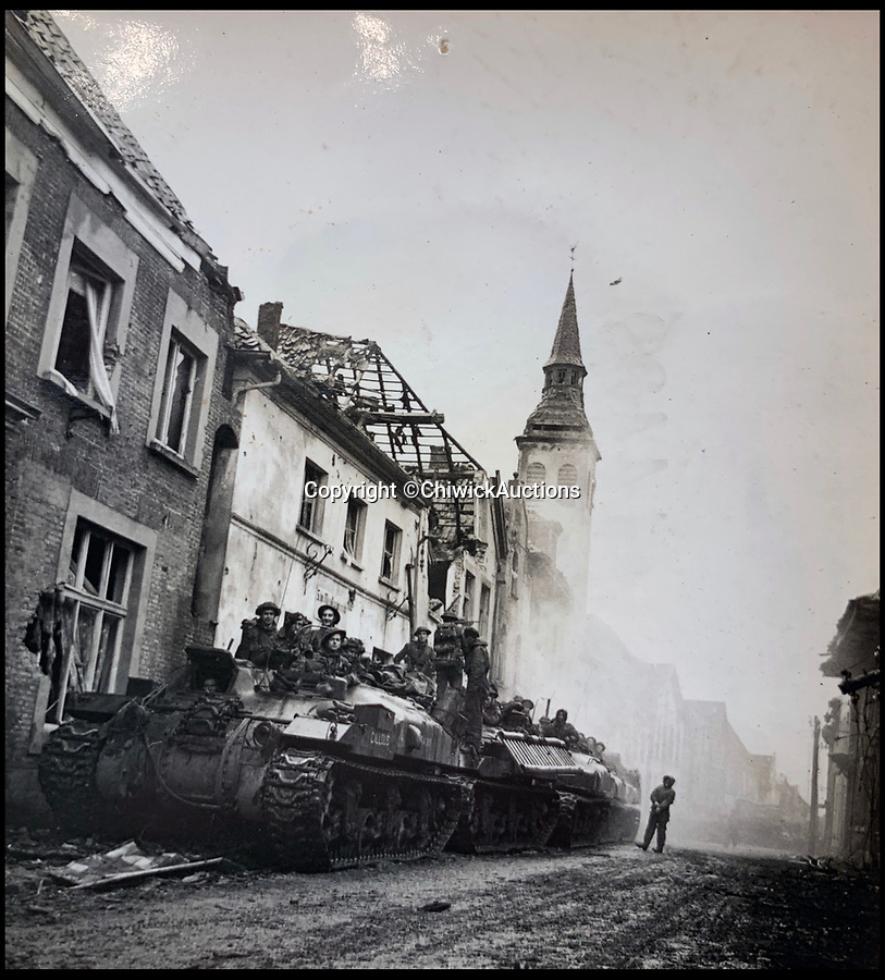 BNPS.co.uk (01202 558833)<br /> Pic:  ChiswickAuctions/BNPS<br /> <br /> Allied troops liberating a town in tanks.<br /> <br /> Remarkable previously unseen photos documenting the momentous closing stages of World War Two and its historic aftermath have come to light.<br /> <br /> They were taken by Sergeant Charles Hewitt, of the Army Film and Photographic Unit, who later went on to work for the Picture Post and the BBC.<br /> <br /> He was present at many of the important offensives of 1944 and '45 including the Battle of Monte Cassino during the Italian Campaign and the Allies advance into Germany following the D-Day invasion.