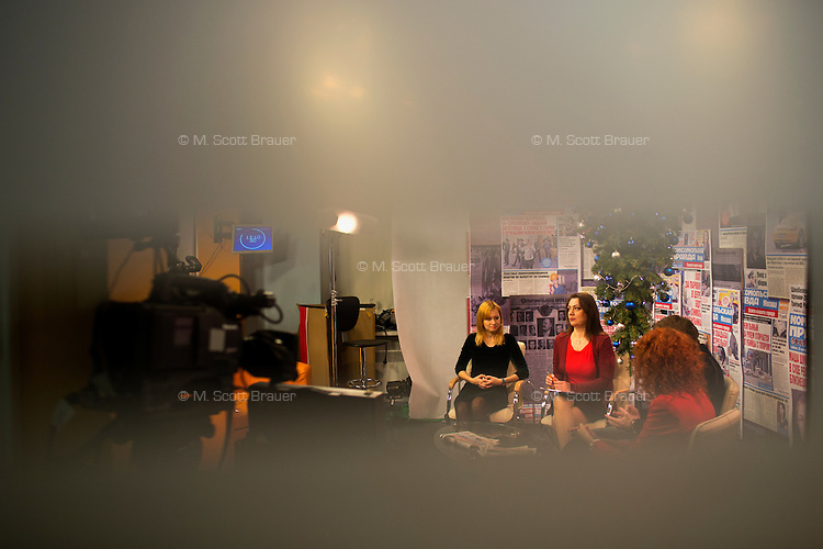 Women discuss the day's news for a chat show produced by Komsomolskaya Pravda in the newspaper's offices in Moscow, Russia.