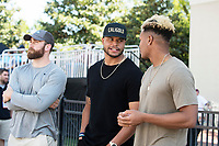 Dak Prescott talking wtih Fred Ross and Richie Brown at the Maroon and White spring football game.<br />  (photo by Beth Wynn / &copy; Mississippi State University)