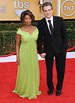 Alfre Woodard and husband arriving at the 19th Screen Actors Guild Awards held at the Shrine Auditorium in Los Angeles, CA. January 27, 2013.