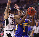 SIOUX FALLS, SD: MARCH 7: Chris Howell #3 of South Dakota State drives past Marcus Tyus #23 of Omaha during the Men's Summit League Basketball Championship Game on March 7, 2017 at the Denny Sanford Premier Center in Sioux Falls, SD. (Photo by Dick Carlson/Inertia)