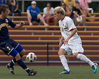 Boston College midfielder Kyle Bekker (10) eludes Quinnipiac University forward Hakon Weloy Aarseth (3). Boston College defeated Quinnipiac, 5-0, at Newton Soccer Field, September 1, 2011.